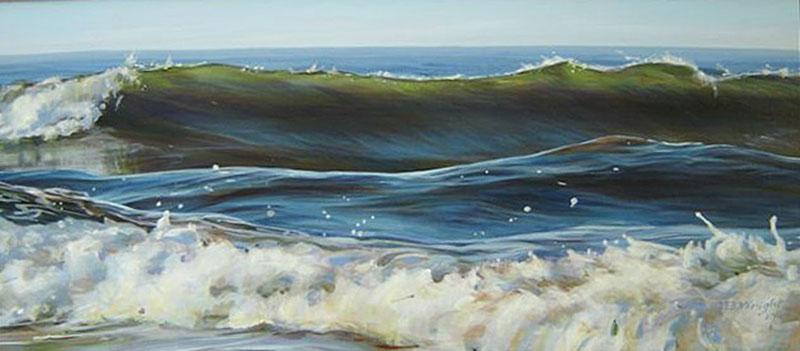 ocean surf with three waves breaking